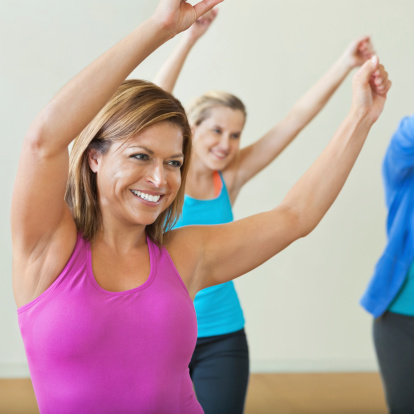 Happy woman dancing in dance fitness class